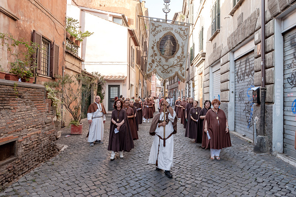 ROME, ITALY - JULY 22: The procession in honor of Madonna del Carmine, called 'de 'Noantri' crossing the streets of Trastevere, Our Lady of Roman Citizens, called 'de 'Noantri', took place to Trastevere on July 22, 2017 in Rome, Italy. The bearers of the statue weighing 1,6 tons, are the Venerable Confraternity of the Blessed Sacrament and Maria del Carmine in Trastevere. The feast was officially instituted in 1927, but the origins date back to the 16th century. In 1535, after a violent thunderstorm, a statue of Mary carved out of cedar wood washed up on the shores of the Tiber. She was brought up the river and given to the then Carmelite church of St. Chrysogonus. (Photo by Stefano Montesi - Corbis/Corbis via Getty Images)
