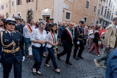 ROME, ITALY - JULY 22: The Mayor of Rome Virginia Ragii during the Solemn celebrations and procession in honor of Madonna del Carmine, Our Lady of Roman Citizens, called 'de 'Noantri', took place to Trastevere on July 22, 2017 in Rome, Italy. The bearers of the statue weighing 1,6 tons, are the Venerable Confraternity of the Blessed Sacrament and Maria del Carmine in Trastevere. The feast was officially instituted in 1927, but the origins date back to the 16th century. In 1535, after a violent thunderstorm, a statue of Mary carved out of cedar wood washed up on the shores of the Tiber. She was brought up the river and given to the then Carmelite church of St. Chrysogonus. (Photo by Stefano Montesi - Corbis/Corbis via Getty Images)